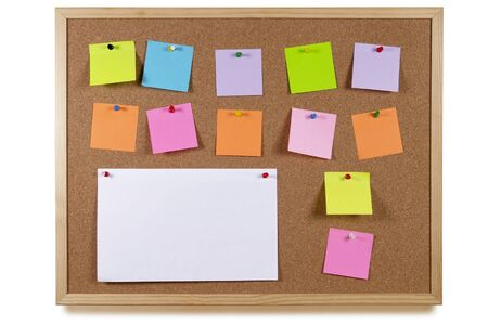 Cork office notice board with blank colorful sticker notes isolated over white background
