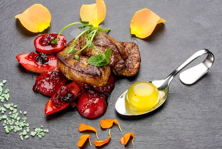Photo for Foie Gras with berries flambe on a dark background - Royalty Free Image