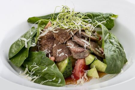 Photo pour Salad with veal tongue, quinoa and avocado. On white background - image libre de droit