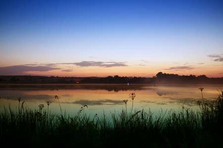 Foto de Vivid pre-sunrise colors  lake on a summer morning - Imagen libre de derechos