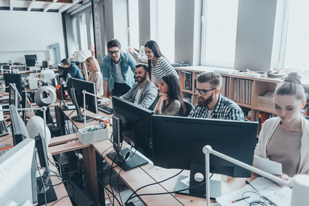 Photo for Best team ever. Group of young business people in smart casual wear working together in creative office - Royalty Free Image