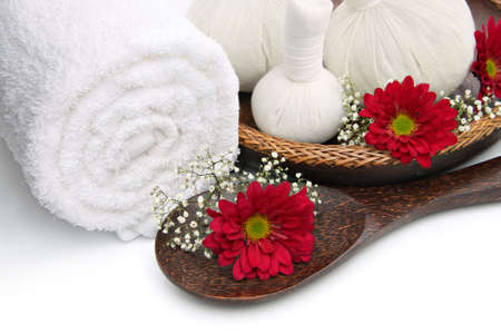 Spa massage border with towel, herbal compress balls and flowers