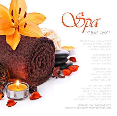 Spa massage border with towel and orange lily flower