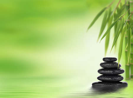Spa background with stacked massage stones