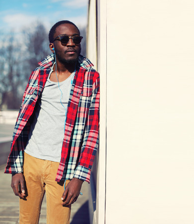 Outdoor fashion portrait of stylish young african man