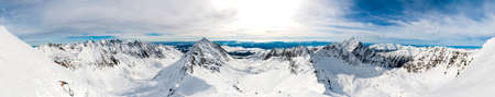 Valleys separated by mountain ridges as seen during the winter - Wide panorama.