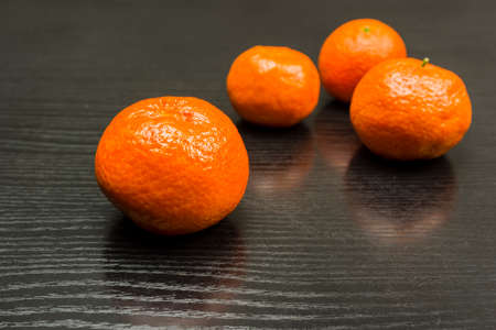 Ripe fruits of sweet mandarins on the table.