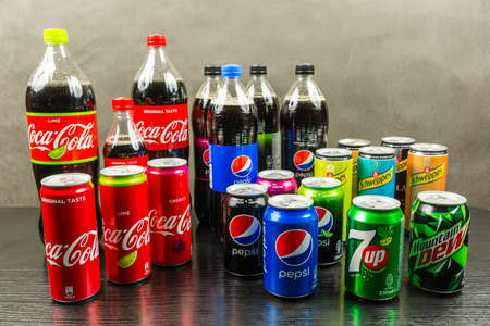 Niedomice, Poland - March 06, 2018: Collection of carbonated soft drinks from different manufacturers (PespiCo, Dr Pepper Snapple Group, The Coca-Cola Company).