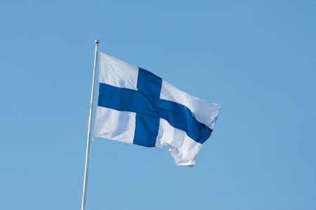 Finnish national flag against clear blue sky