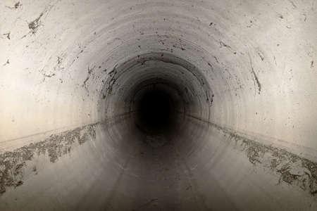Empty sewer channel dark interior