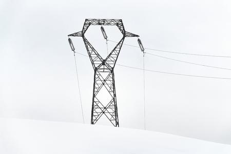 Photo pour Electric power lines in snow - image libre de droit