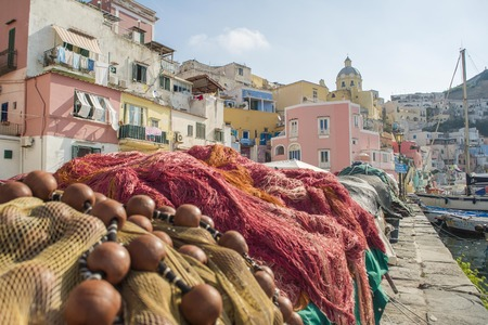 The fisherman's house and the fish nets on Port of Corricella in Procida Island, Italy