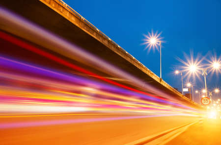 Foto de High speed traffic and blurred light trails under the overpass at night scene  - Imagen libre de derechos