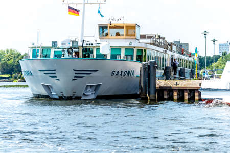 Potsdam, Brandenburg/Germany - 07.23.2018: The passenger ship Saxonia for river cruises is located at the jetty in Potsdam and is waiting for the next voyage.