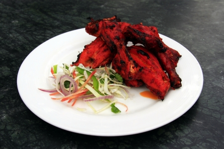 Tandoori chicken served with fresh salad - north indian food