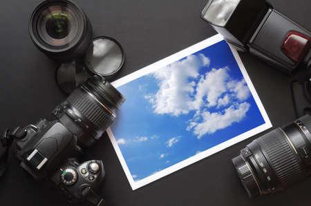 dslr camera lens and image on black background
