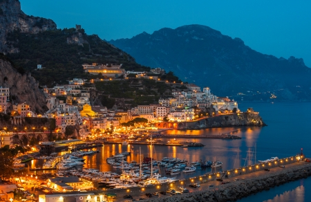 Aerial view of the Amalfi Coast with Amalfi city at night, Italy