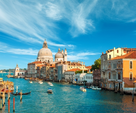 Foto per Beautiful view of the Grand Canal and Basilica Santa Maria della Salute in the late evening with very interesting clouds, Venice, Italy - Immagine Royalty Free