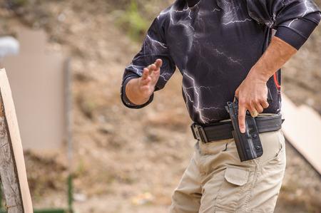 Man Pulling Gun in Training, Outdoor Shooting Range