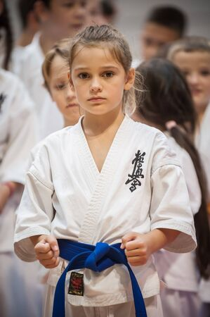 BELGRADE, SERBIA - 28. SEPTEMBER 2019. Cute little girl in kimono on Martial Arts Sport Demonstration. Evening of Martial Arts / Kyokushin Belgrade Trophy at Sport Center RADIVOJE KORAC