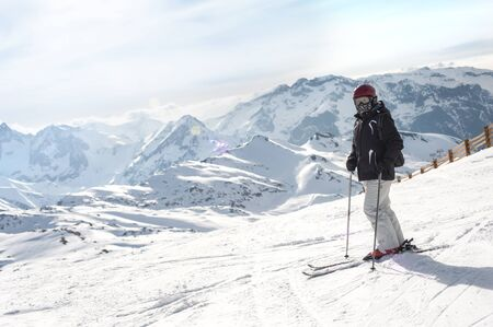 Female skier enjoy in beautiful snowy alps mountain range scenic. Winter season sport and recreation travel concept