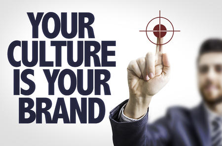 Business man pointing the text: Your Culture is Your Brand