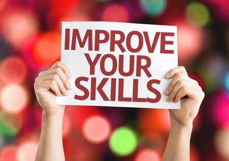 Photo pour Hands holding Improve Your Skills card on bokeh background - image libre de droit
