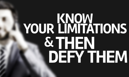 Business man with the text Know Your Limitations & Then Defy Them in a concept image
