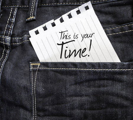 This Is Your Time written on a piece of paper on a jeans background