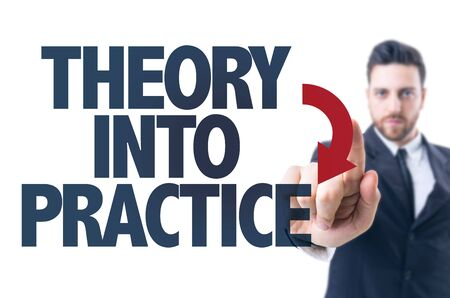 Photo pour Business man pointing the text: Theory Into Practice - image libre de droit