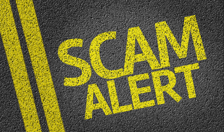 Scam Alert written on road
