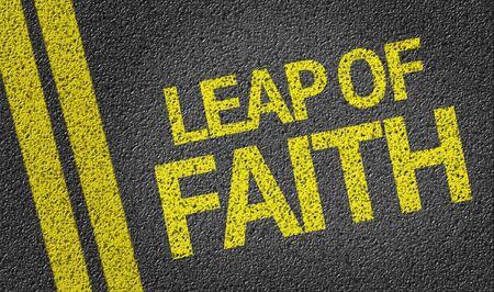 Leap Of Faith written on asphalt road