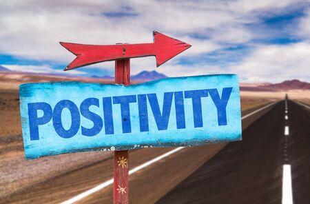 Photo pour Signpost with the text Positivity on road background - image libre de droit