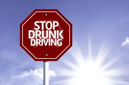 Stop Drunk Driving written on the road sign
