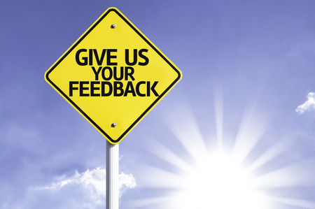 Give us your feedback sign with sunny background