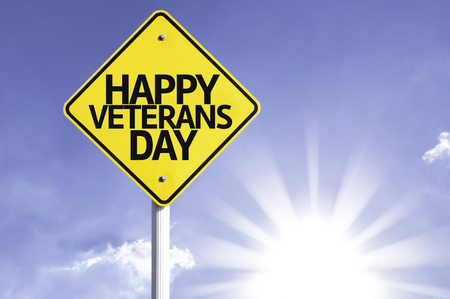 Happy Veterans Day sign with sunny background