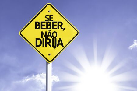 Se beber, nao dirija (don't drink and drive in Portuguese) sign with sunny background