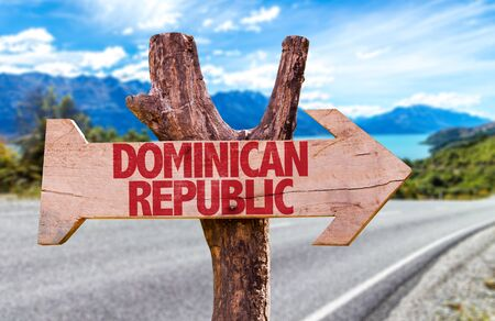 Dominican Republic sign with arrow on road background