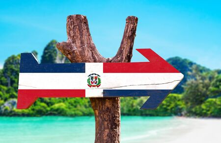 Dominican Republic flag wooden sign board in wetland background