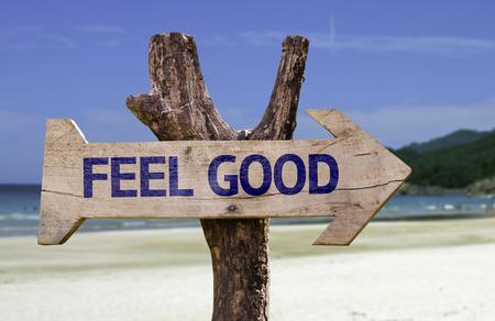Feel good sign with arrow on beach background