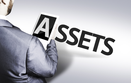 Business man in low angle view with the text: Assets