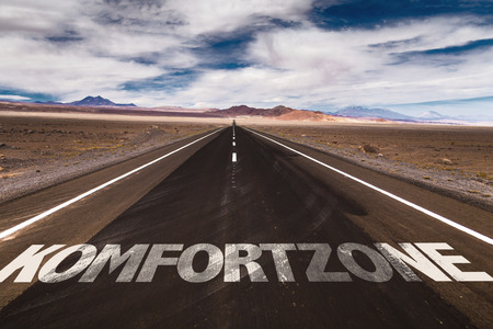 Photo for Komfortzone (comfort zone in German) written on the road - Royalty Free Image