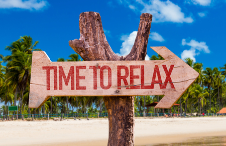 Time to relax sign with arrow on beach background