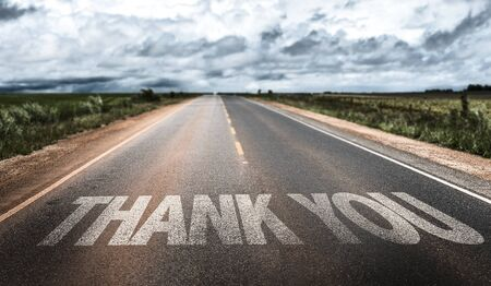 Thank you written on the road
