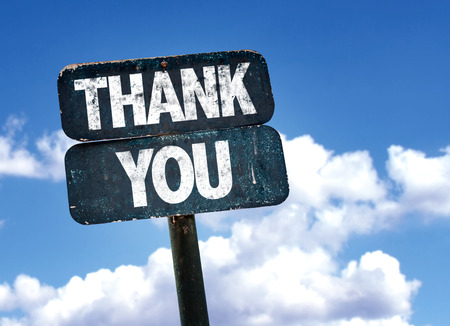 Thank you written on the road sign with clouds and sky background