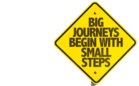 Photo for Big journeys begin with small steps sign on white background - Royalty Free Image