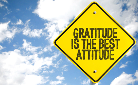 Gratitude is the best attitude sign with clouds and sky background