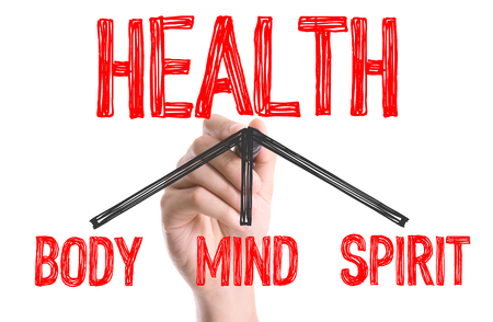 Hand with marker writing the word Health - BodyMindSpirit