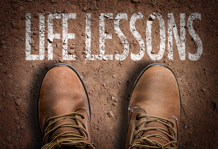 Photo pour Text on road with boots background: Life lessons - image libre de droit