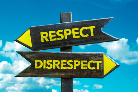 Text sign with arrow on clouds and sky background: Respect/disrespect
